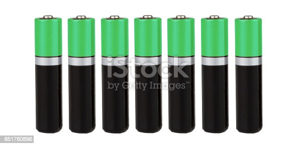 istock Seven batteries of the type AAA in a row, green, on a white background, isolated 651760896