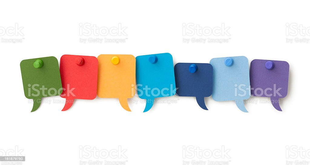 Seven blank colourful speech bubbles pinned to a white surface stock photo
