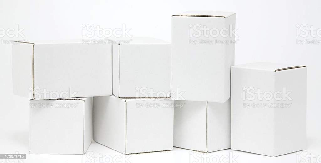 Seven blank white cartons isolated royalty-free stock photo