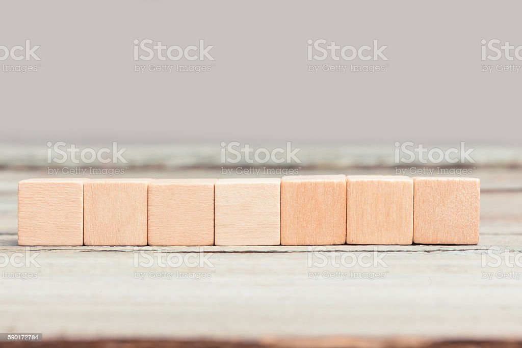 Seven blank wood cubes stock photo