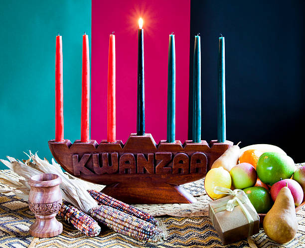 seven colorful candles in celebration of kwanzaa - kwanzaa stock pictures, royalty-free photos & images