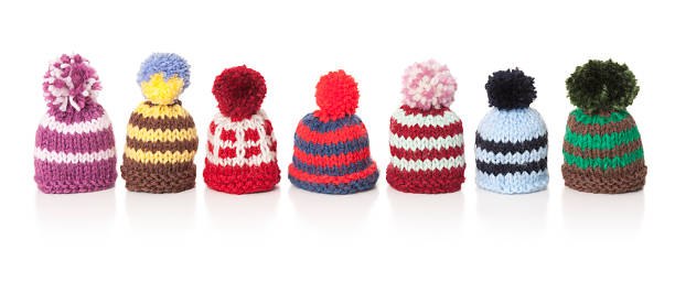 Seven colourful woolly hats stock photo