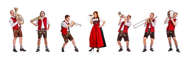 Seven costumed members of a Bavarian/Austrian brass band Bavarian/Austrian brass band with female singer. davelongmedia stock pictures, royalty-free photos & images