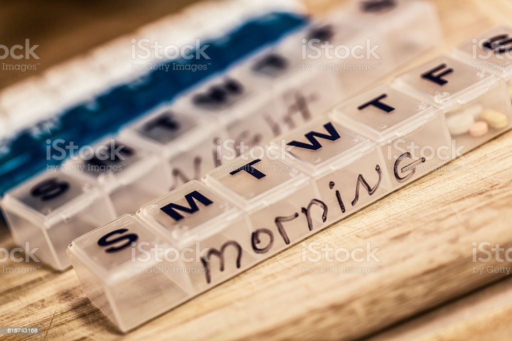 Seven Day Weekly Morning and Night Pill Containers stock photo