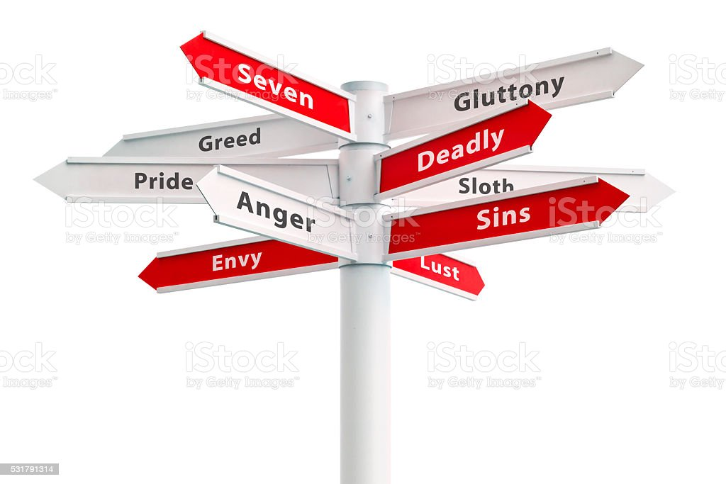 Seven Deadly Sins On Crossroads Sign stock photo