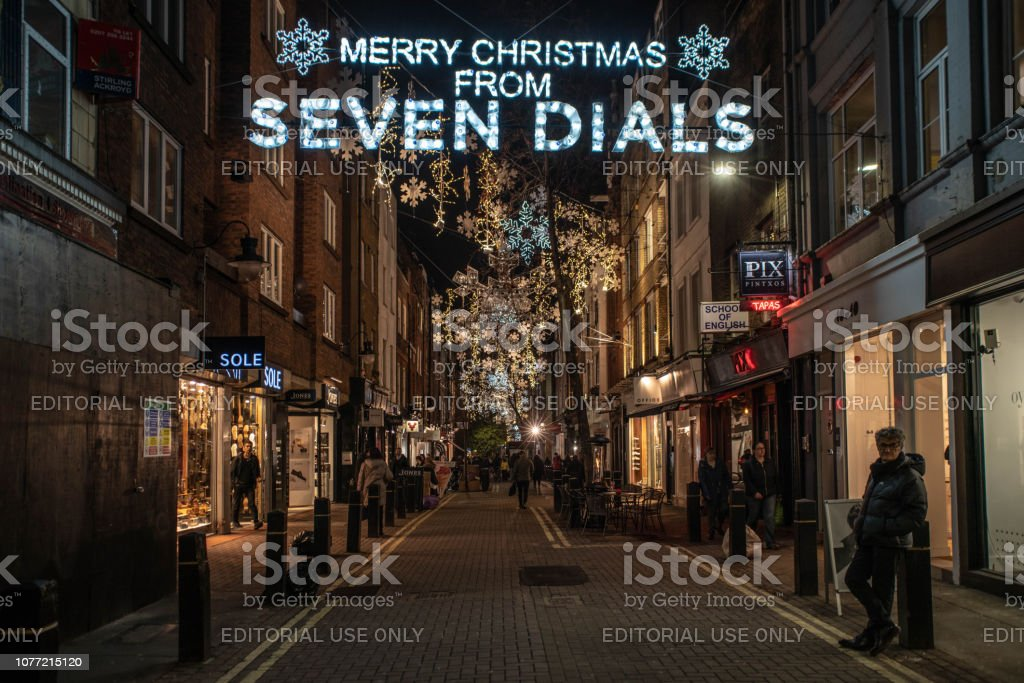 Seven dials district of London with Christmas Lights welcoming tourists stock photo