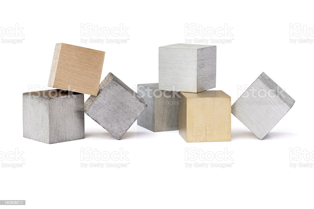 Seven different metal cubes isolated on white royalty-free stock photo