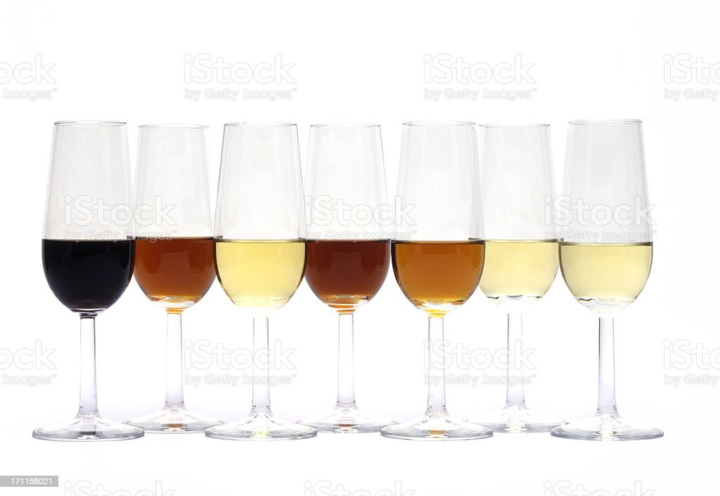 seven glasses of different sherry stock photo