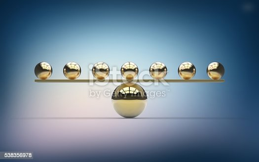 Seven small gold metallic balls balancing on one large gold ball. Imbalance. Weight scale.