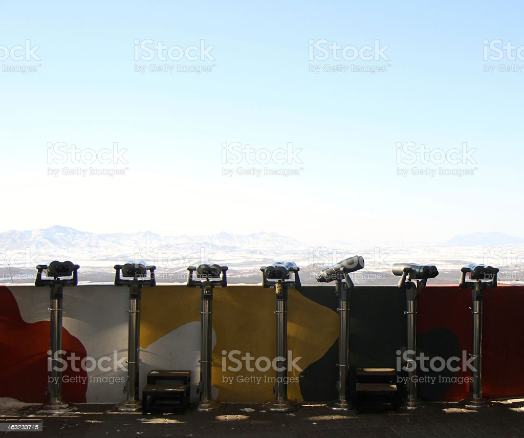 Seven long range coin operated binoculars in a row stock photo
