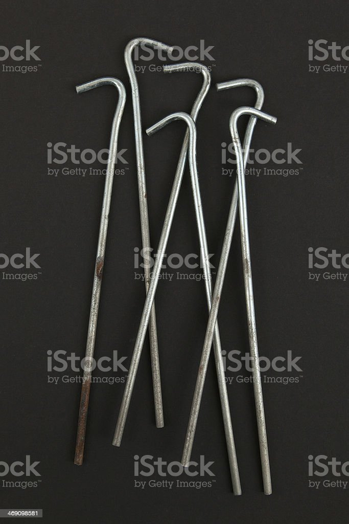 Seven round metal tent pegs royalty-free stock photo