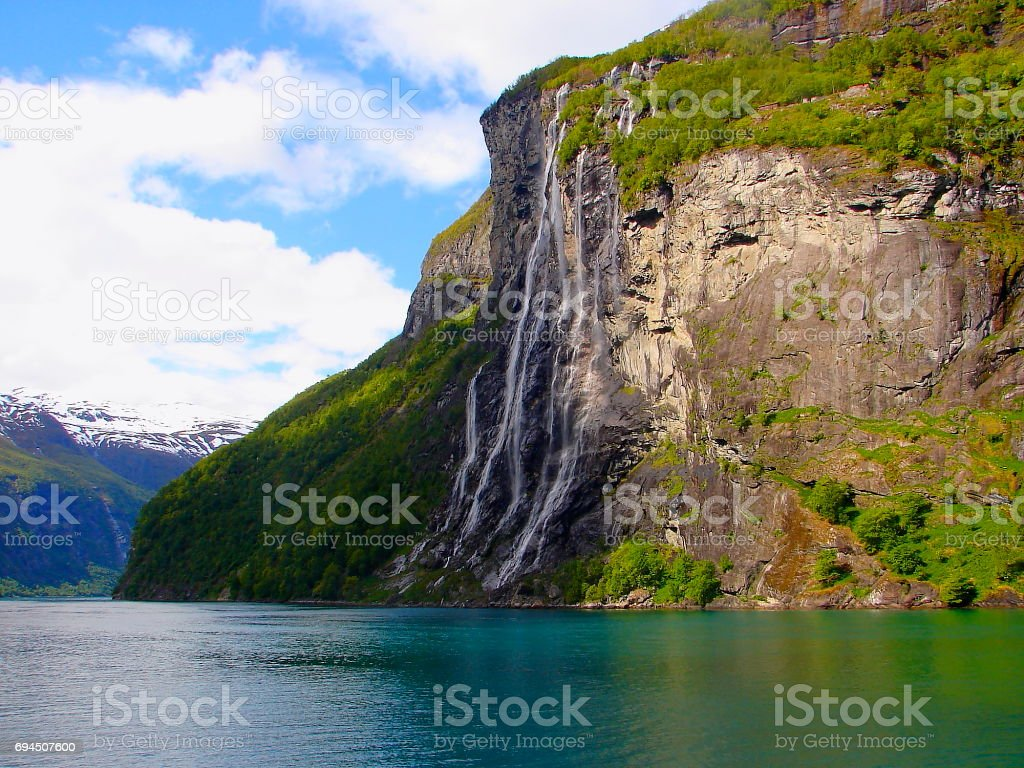 Seven sisters Waterfall - Crossing Norway impressive Geiranger Fjord by Ferry, Norwegian dramatic landscape, Scandinavia – Nordic Countries stock photo