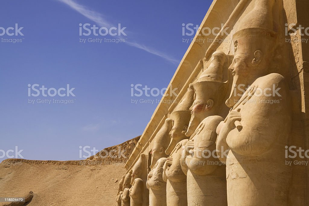 Seven statues look out over the nile luxor west bank stock photo