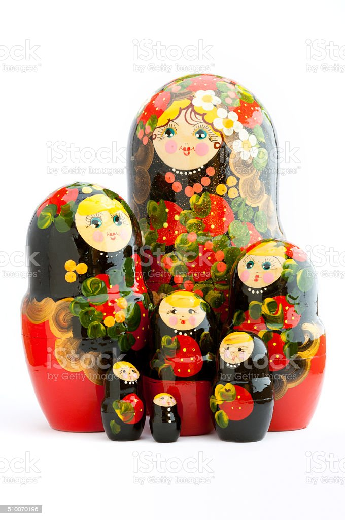 Seven traditional Russian matryoshka dolls on white background stock photo