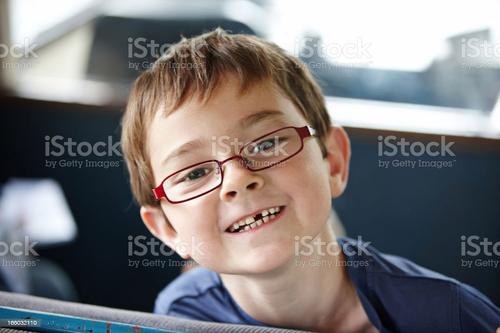 Seven year old boy smiling showing missing front tooth stock photo