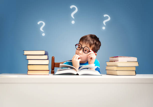 Seven years old child reading a book stock photo