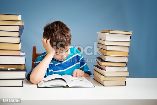 683105722 istock photo seven years old child reading a book 656158294