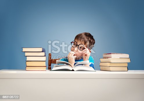 istock seven years old child reading a book 683105722
