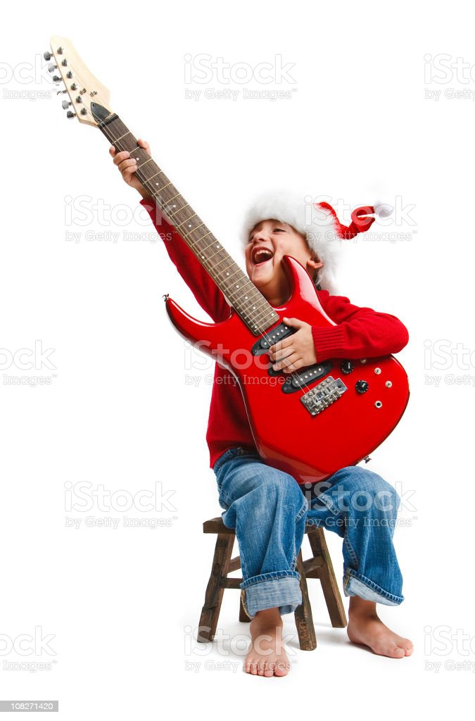 seven years old santa kid with red guitar stock photo