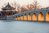Seventeen Hole Bridge of Summer palace at dusk. Only in  the winter solstice (Chinese Calendar, the day is the shortest day), each of the bridge hole can be illuminated fully by the sunshine at dusk.