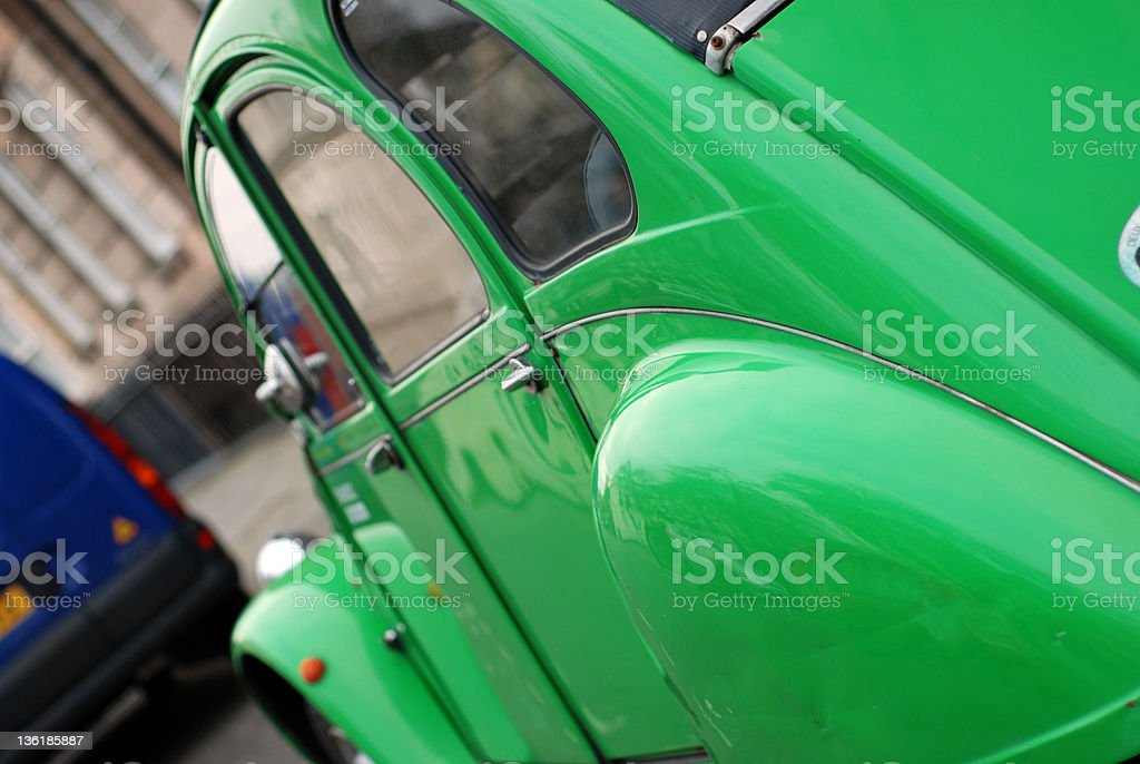 Seventies green car in street with copy space stock photo