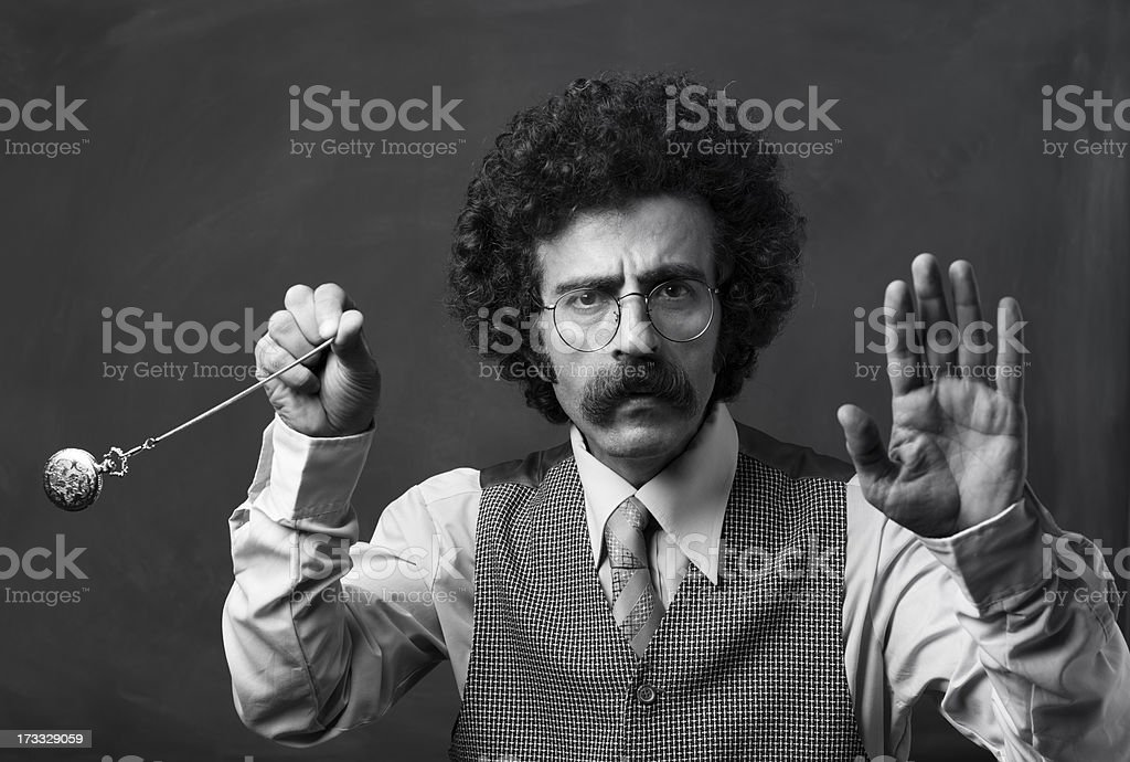 Seventies psychiatrist swinging pocket watch for hypnosis stock photo