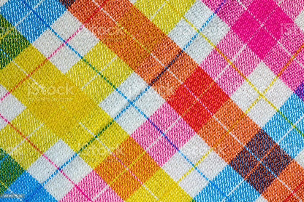 Seventies retro bright colored baby blanket with diagonal plaid stock photo