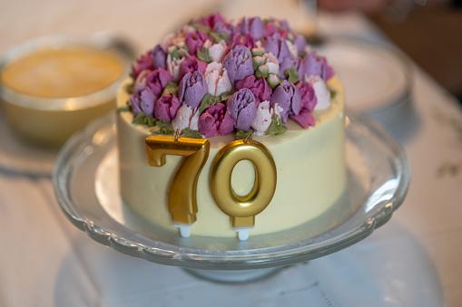 Seventieth birthday cake on glass stand