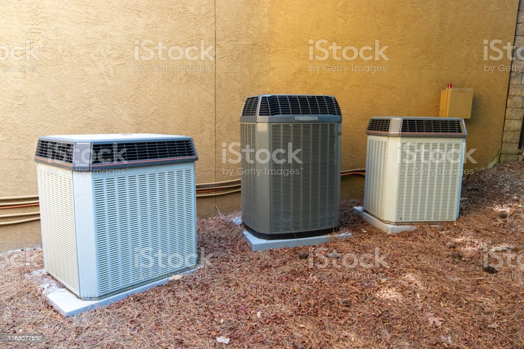 Several Ac Units Next To Home Stock Photo Download Image Now Istock