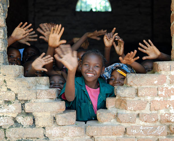 Several African children waving hands in Tchad stock photo