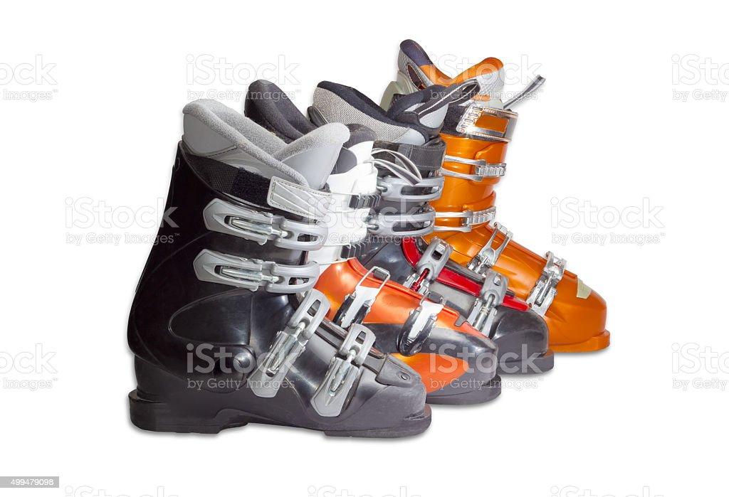Several alpine ski boots on a light background stock photo