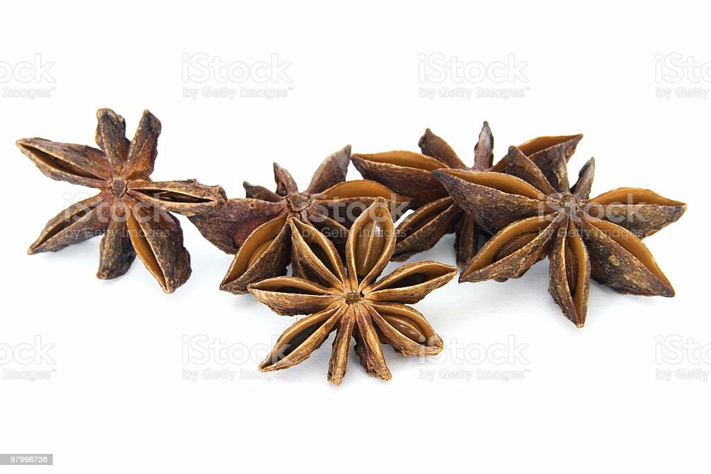 Several anise stars on white royalty free stockfoto