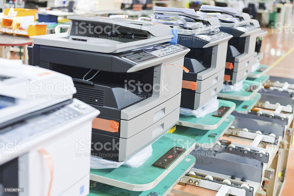 several assembled copiers on factory stock photo