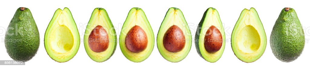 Several avocados whole and cut, with a seed and without isolated on a white background, clip art stock photo