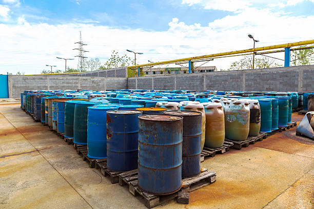 Several barrels of toxic Several barrels of toxic waste at the dump toxic waste stock pictures, royalty-free photos & images