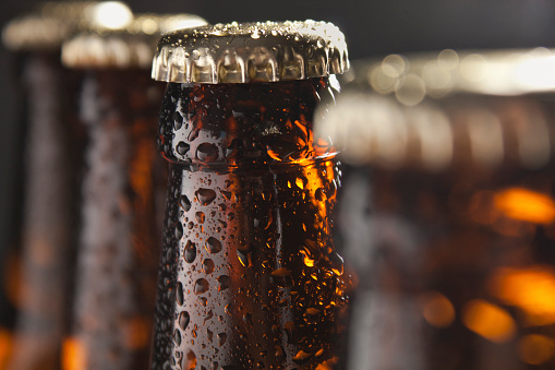 Several beer bottles with condensation