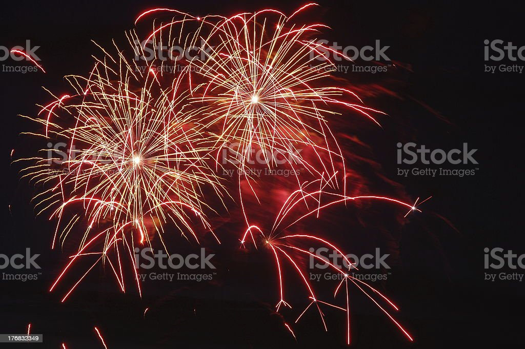 Several blasts of red Fireworks against black royalty-free stock photo