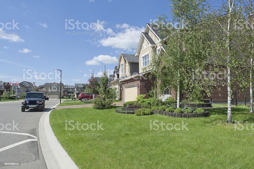 Several brand new suburban houses in sunny summer afternoon. Hou royalty-free stock photo