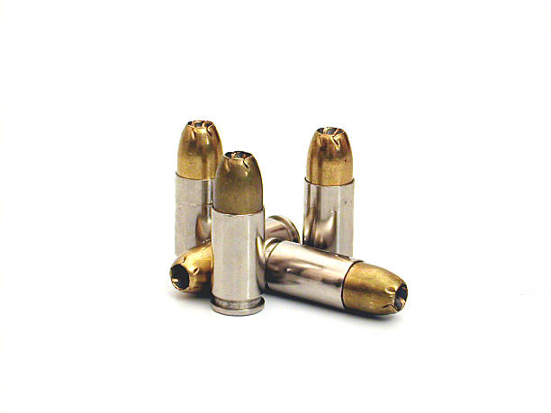 Several bullets isolated on a white background several 9mm hollow point bullets ammunition stock pictures, royalty-free photos & images