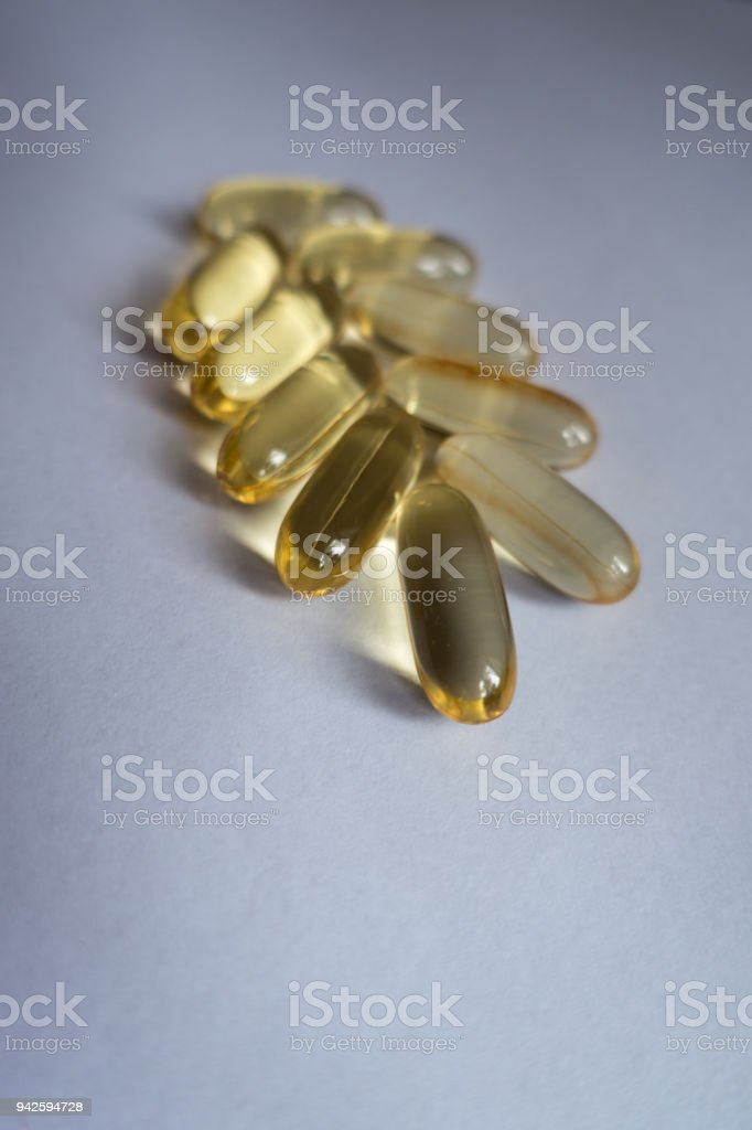 Several capsules of fish oil in a shape of spike stock photo