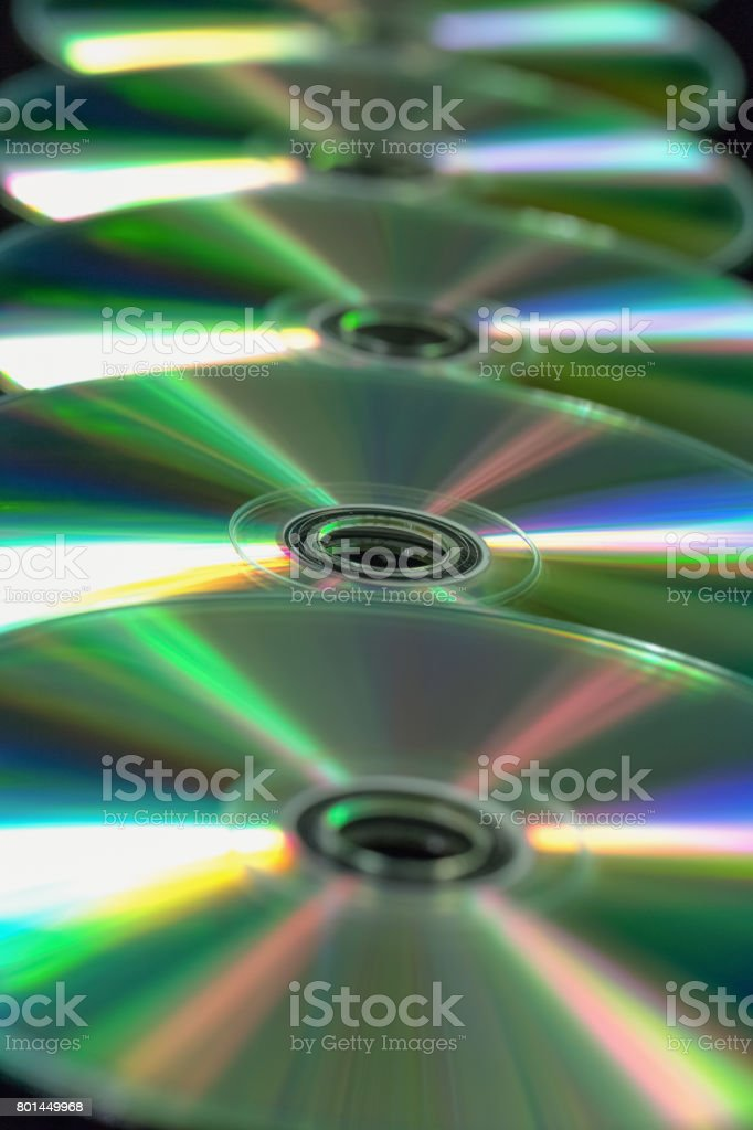 Several CD / DVD in a straight line. Top view stock photo