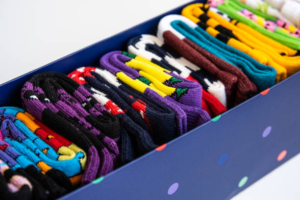 Several colorful cotton socks rolls in a box stock photo