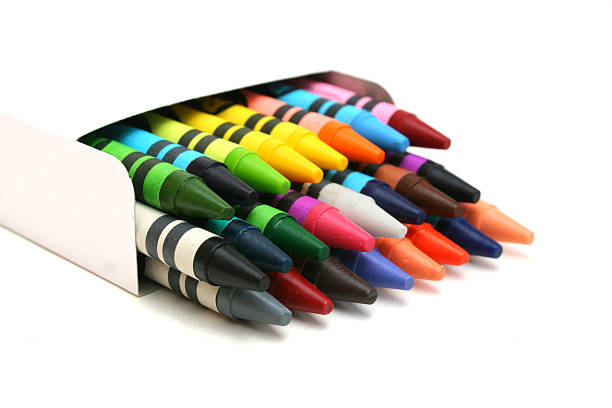 Several crayons in white box laid down stock photo