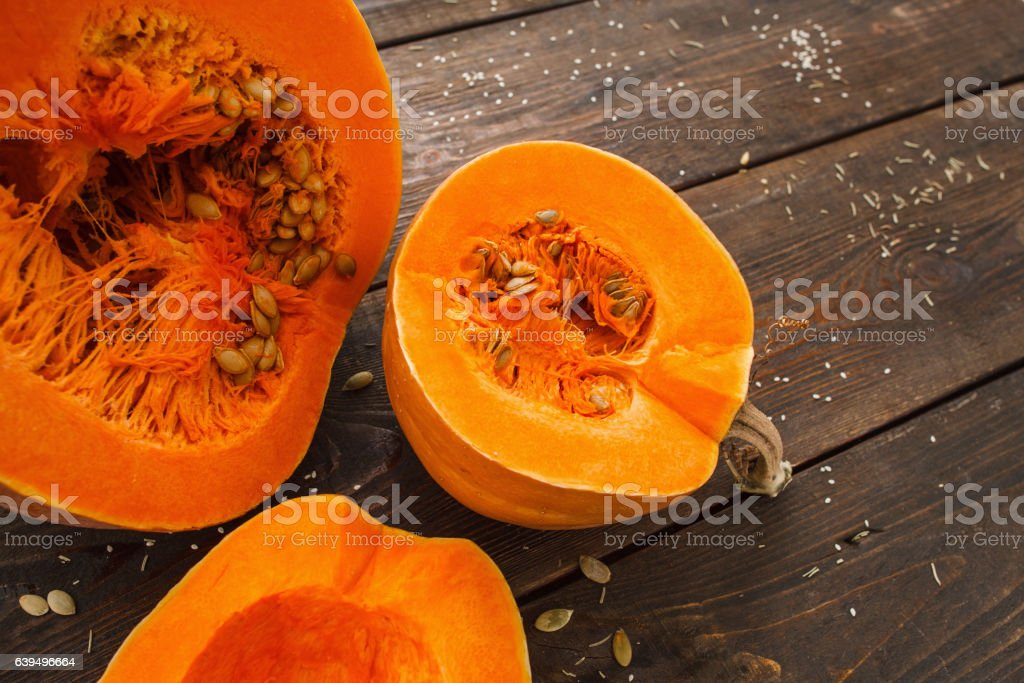 Several cut pumpkins on wood closeup stock photo