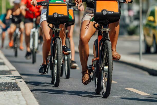 Several cyclists pass through a bike path in the Copacabana neighborhood (Rio de Janeiro, Brazil) stock photo