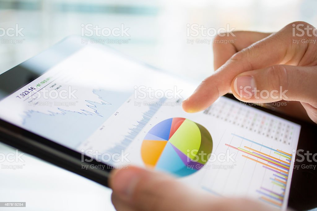 Several different graphs depicted on digital tablet stock photo