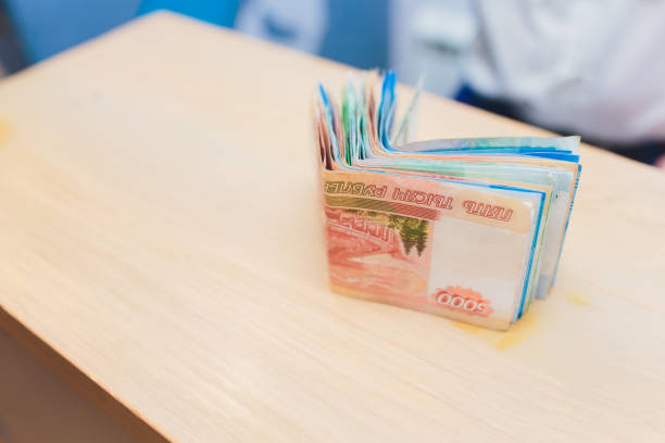 several different rubles banknotes on the table. background. - disbursement stock pictures, royalty-free photos & images