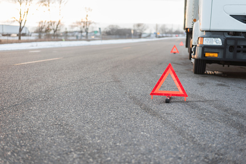 several emergency triangles by truck on road