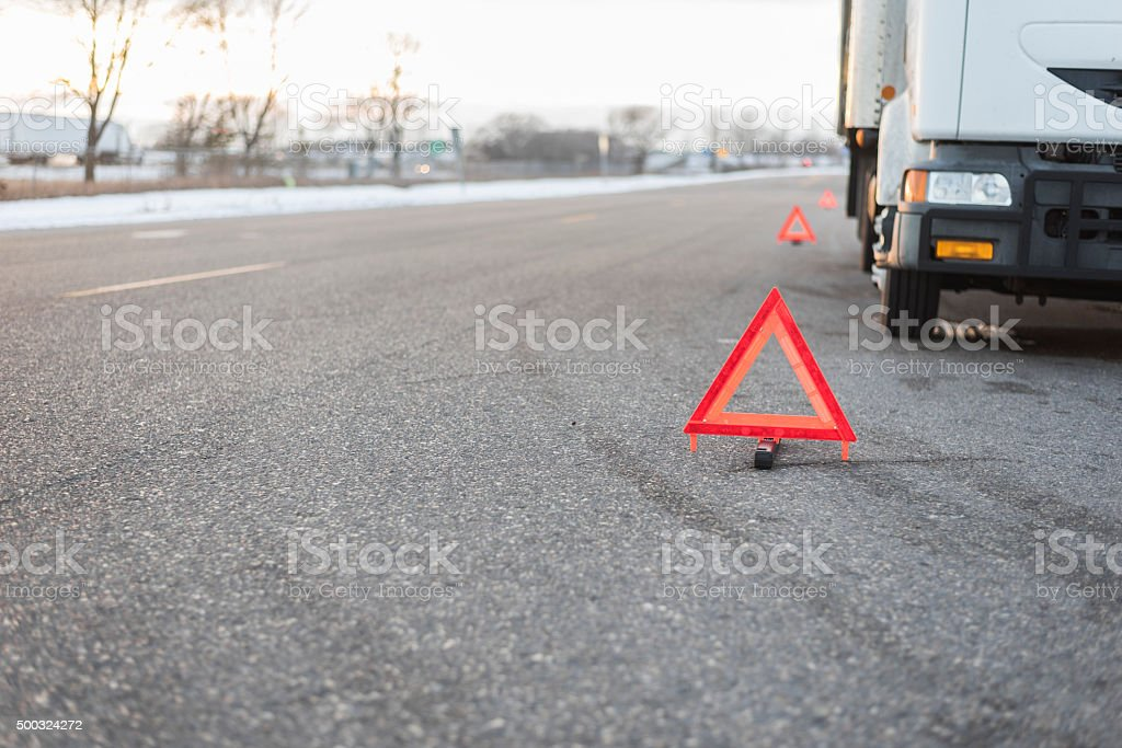 several emergency triangles by truck on road stock photo