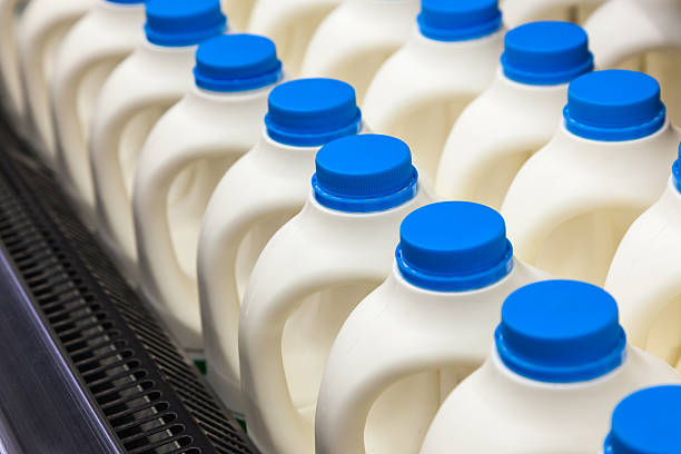 Several gallons of milk bottles in a store stock photo